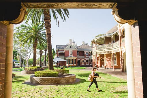Student walking through the ACU Strathfield Campus.